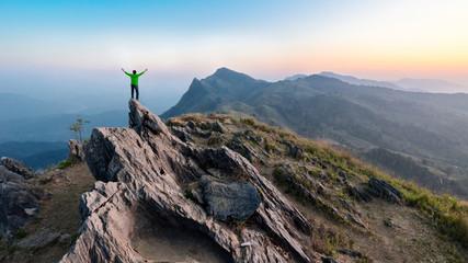 Winner man on peak of rocks mountain Hike at sunset, Active life