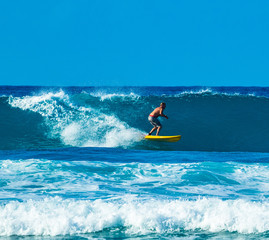 surfer in good waves in the caribbean