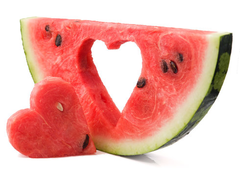 Heart cut out of the ripe watermelon on a white background, isolated