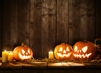 Scary halloween pumpkins on wooden planks