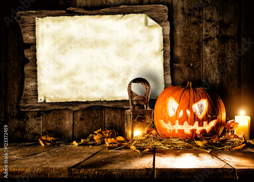 Scary halloween pumpkin with blank board