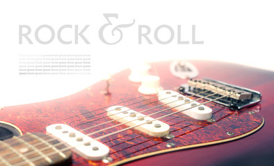 Concept of classic electric guitar isolated on white background with text Rock n roll and space for another text in retro style