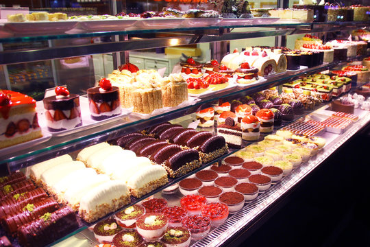 Pastry shop display window with cakes