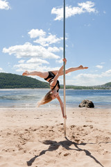 blonde dancing on pole for performing acrobatic