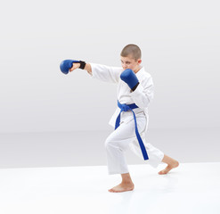 Karateka beats punch with blue overlays on hands
