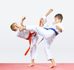 Children athletes are training kicks legs
