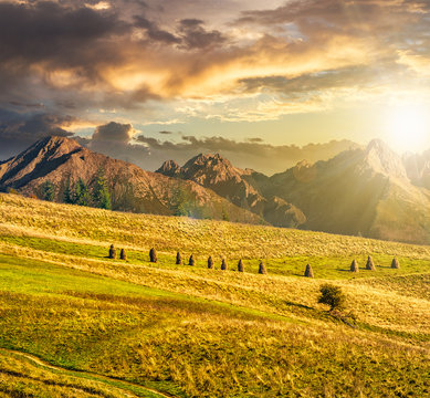Rural fields near the high mountains at sunset
