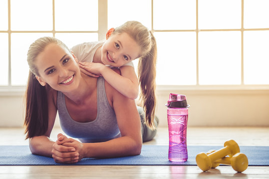 Mother and daughter doing sport