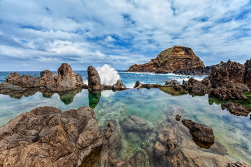 Wall Mural - Lava rocks natural volcanic pools in Porto Moniz, Madeira, Portugal.