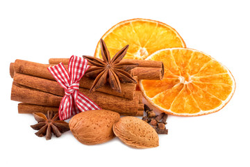 Christmas spices cinnamon anise cloves almond nuts dried orange isolated on white