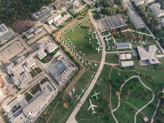 Sky and aerial view of the Air park near Krakow city center. Airport terminal, air crafts, roads, buildings