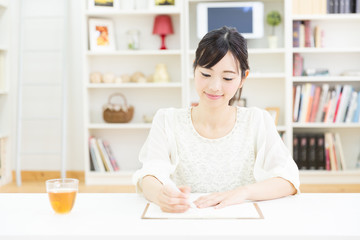attractive asian woman writing
