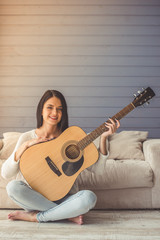 Attractive girl playing guitar