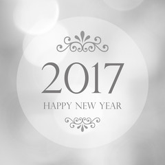 Happy New Year 2017 year on abstract blur  bokeh background