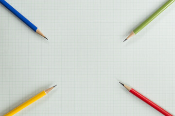 close-up colorful pencils on graph paper