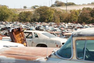 Broken cars at junkyard