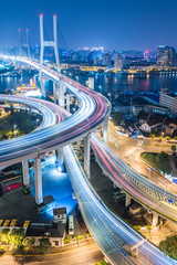 Busy highway traffic light trails at night in city of China.