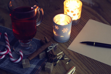 Christmas letter on the table with spices