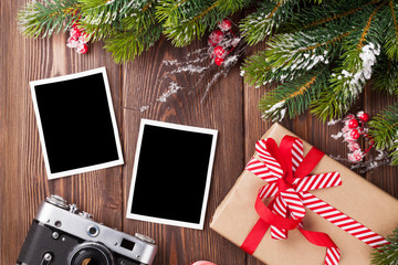 Blank photos with christmas gift, pine tree and camera