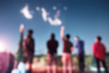 Blurred scene group of friends celebrating with fireworks