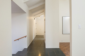 Tiled Hallway Inside Modern Home in Gallery style