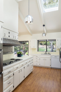 Classic White Kitchen with Wooden Floor Silver Appliances and Na