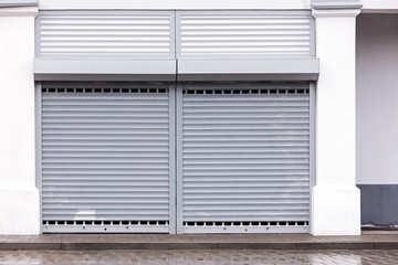 warehouse facade wall with grey corrugated metal gate