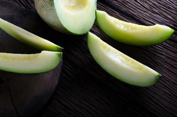 Healthy fruit ripe melon dark tone background.melon