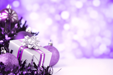 Purple Christmas scene with baubles and gift