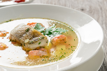Beautiful presentation of the fish soup.
