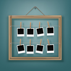 Set of Wooden Clothespins Pegs whith Blank Retro Photo Frames and Picture Frame on Rope Close up Isolated on Background