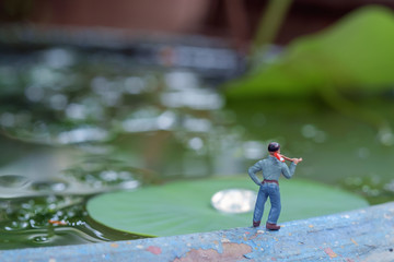 Toy lumberman / View of miniature toy, lumberman standing in the park.