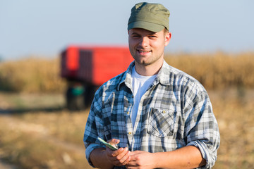 Happy farmer after harvest of corn