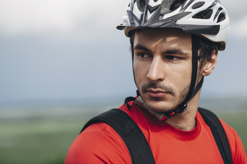 Portrait of confident man wearing bicycle helmet