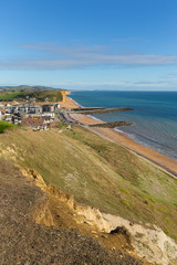 West Bay Dorset uk view to east of the Jurassic coast on a beautiful summer day with blue sky and sea