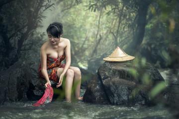 Asian sexy woman washing in streams