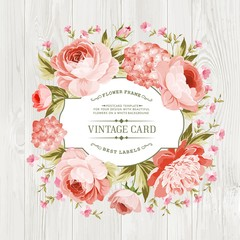 Pink peony with a vintage label over wooden texture. Vector illustration.