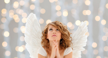praying teenage angel girl or young woman
