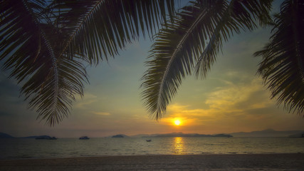 Sunrise on tropical beach background at Phayam island in Ranong province, Thailand. Happy summer holiday concept