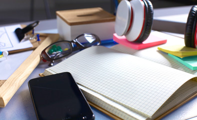 Desk of an artist with lots  stationery objects. Studio shot on wooden background