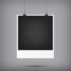 Abstract background blank instant photo frame hanging with black