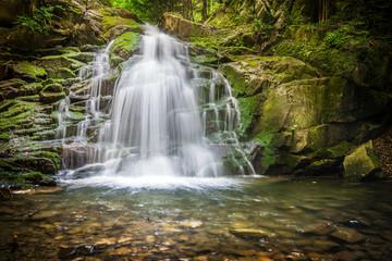WODOSPAD WIELKI, OBIDZA, POLAND - JUNE 10, 2016: A view from mountain river of small waterfall in Obidza, Poland