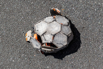punctured football in the street