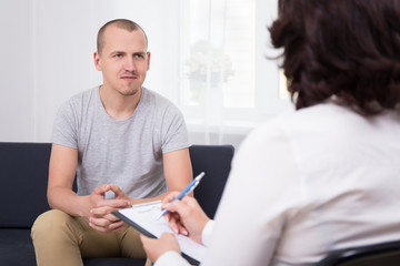 happy young man at interview in office