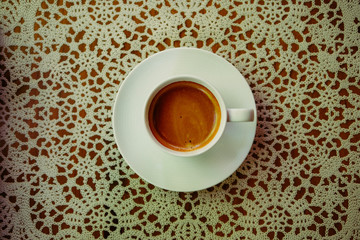 Espresso Coffee Drink in Simple White Mug on table. top view