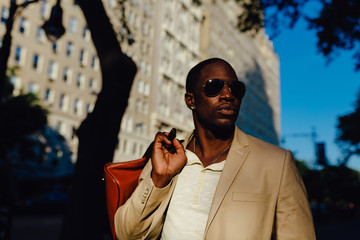 Young Black Businessman Walking on the Streets of Manhattan . New York City