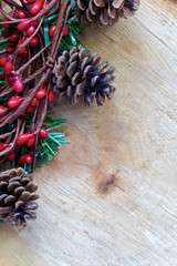 Christmas decorations on a rustic log with space for text