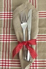 Knife and fork with checked tablecloth