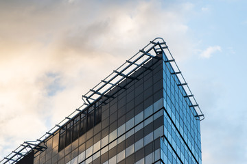Modern office building with cloudy sky