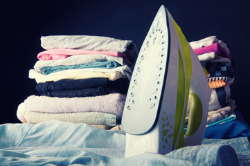 Iron and clothes. Ironing